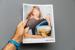 LVMH Louis Vuitton luxury pourse advertising in French press Stock Photo