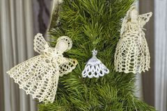 LVOV, UKRAINE- JANUARY 20 2018: Lace Christmas angels on the Ch. Ristmas tree. Christmas decorations royalty free stock images