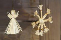 LVOV, UKRAINE- JANUARY 20, 2018: Straw Christmas angel and sun. Christmas decorations stock images