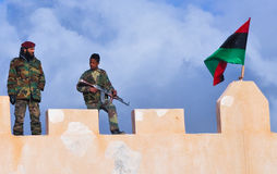 Lybian young soldier. A soldier and an armed child on a roof during the demonstration celebrated for the first year of the lybian revolution. Feb 17 2012 Royalty Free Stock Photography