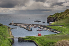 Lybster harbor and cliffs to its south, Scotland. Stock Images