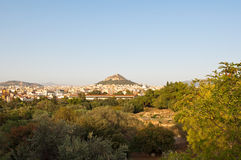 Lycabettus pine covered hill  from Filopappos Hill in Athens, Greece. Stock Photos