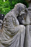 The Lychakiv cemetery in Lviv Ukraine. classic sculpture sad sorrowful woman at. Classic sculpture sad sorrowful woman at the Lychakiv cemetery in Lviv Ukraine Stock Image