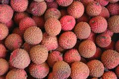 Lychee. Myriad of lychees on sale stock photo