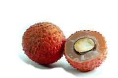 Lychee. Fruit with half cut revealing fresh Royalty Free Stock Photography