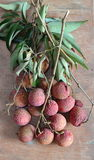 Lychee Asian fruit on wooden board Stock Images