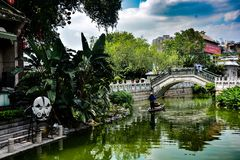 Lychee Bay  in Guangzhou,China. Clear River under widen sky in Lychee Bay  of Guangzhou China, water flowing beneath a little bridge royalty free stock photos