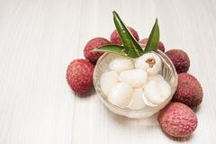 Lychee casing in the cup and fruit. Background or wallpaper Stock Photography