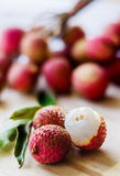 Lychee fruit on a wooden board Stock Image