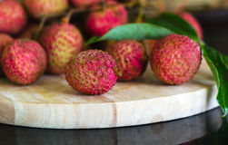 Lychee fruit on a wooden board Royalty Free Stock Image