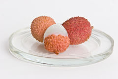 Lychee fruits. On glass plate isolated on white Stock Photos
