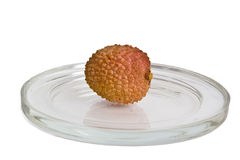 Lychee fruits. Single Lychee fruit on glass plate isolated on white Royalty Free Stock Photo