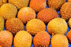 Lychee jest wyśmienicie, fragrant, czerwonawym egzotycznym owoc, Lychee wielką dostawę pożytecznie odżywki Ja używa w kucharstwie obrazy royalty free