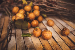 Lychee - Litchi chinensis closeup on brown board Stock Photos