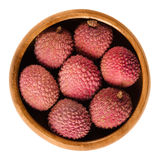 Lychee or litchi fruits in wooden bowl over white Stock Images