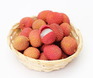 Lychee in a little basket. Isolated on white background royalty free stock photography