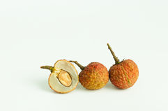 Lychees. Three fresh lychees on white background Stock Images