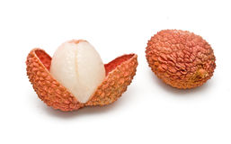 Lychee and peeled lychee Royalty Free Stock Photo