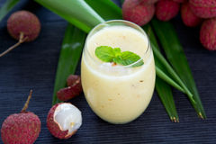 Lychee,Pineapple and coconut smoothie. Fresh Lychee,Pineapple and coconut smoothie with mint on top Stock Photo