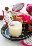 Lychee,Pineapple and Dragon fruit smoothie. Fresh Lychee,Pineapple,Coconut and Dragon fruit smoothie in glass Stock Photo