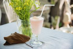 Lychee smoothie. In glass with yellow flower and golden leaf decorated royalty free stock images