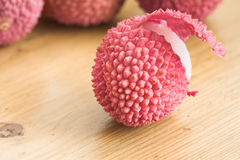 Lychee to be peeled stock image