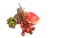 Lychee, watermelon and pineapple on white Stock Photos