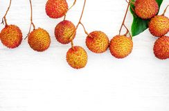 Lychee on white wood floor,Thai fruits on white wood floor and s. Pace Royalty Free Stock Image