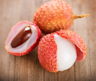 Lychee on a wooden table Royalty Free Stock Image