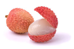 Lychees. Close-up studio shot of two lychee. One open. Open still close. Isolated. White background Stock Image