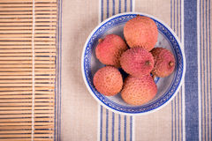 Lychees in bowl Stock Photography