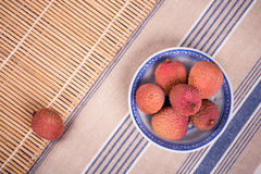Lychees in bowl Royalty Free Stock Image