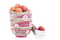 Lychees in bowls with spoons Stock Image