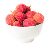 Lychees fruits in bowl isolated Royalty Free Stock Images