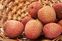 Lychees in a wicker basket. Some fresh whole ripe lichees on a wicker basket Stock Images