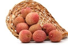 Lychees in a wicker basket. Some fresh whole ripe lichees on a wicker basket Royalty Free Stock Photo