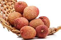 Lychees in a wicker basket. Some fresh whole ripe lichees on a wicker basket Royalty Free Stock Image