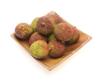 Lychees on a wooden plate Royalty Free Stock Photography