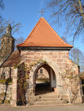 Lychgate. This old lychgate can be found at the little village of Labach in the Palatine area of Germany. A lychgate is a roofed wooden or stone gateway to a Stock Photo