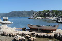 Lycian Tomb And Boat Royalty Free Stock Photography