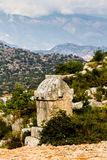 Lycian tombs against the backdrop of the mountains in Simena. Stock Photos