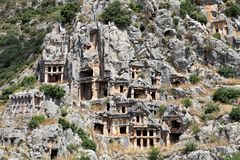 Lycian tombs carved in the rock in Myra Turkey Royalty Free Stock Photo