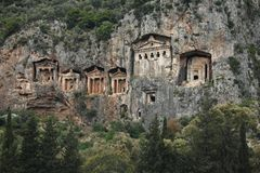 Lycian Tombs, Kaunos,Turkey. Ancient stone Lycian tombs carved from vertical cliffs near the ancient Kaunos Ruins, Turkey stock images