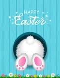 Lyckönsknings- påskkort med en lycklig påsk för hand-skriftlig inskrift och en vit fluffig kanin underifrån i ett hål mot stock illustrationer