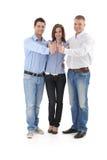 Lyckad affärsgrupp som gör upp tummen Arkivfoton