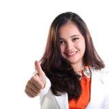 Lyckad affärskvinna som ger upp tummen Royaltyfria Bilder