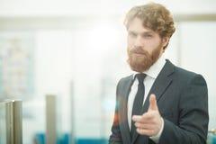 Lyckad affärsman i regeringsställning Arkivfoto