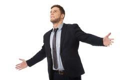 Lyckad affärsman med öppna händer Arkivbild