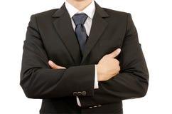 Lyckad affärsman med korsade händer. Arkivfoto
