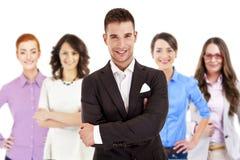 Lyckad affärsman som leder en grupp Arkivbild